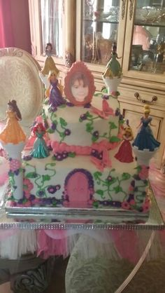Disney Princesses themed cake with licensed toys