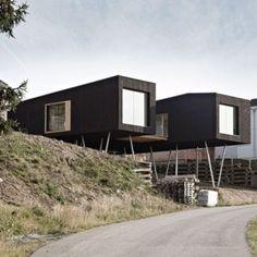 Black-painted S House by Hammerschmid Pachl Seebacher Architekten.