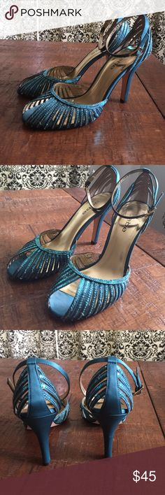 Bebe blue turquoise strappy sandal heels Beautiful heels with sequins on straps. They are worn but in great shape. Size 8 1/2 true to size. bebe Shoes Heels