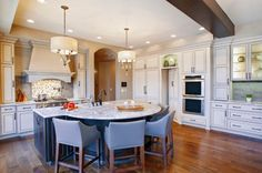 kitchen island with seating for 4 granite countertops recessed panel cabinets hardwood floors multicolored backsplash ceiling lights pendants sink traditional design of Fabulous Islands to See If You Want a Kitchen Island with Seating for 4