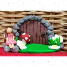 Handmade polymer clay fairy door with fairy, toadie and daisies