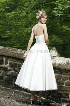 BUY NOW FROM $70 http://souqzila.com/products/new-applique-beaded-crystal-ruffles-sleeveless-sweetheart-a-line-tea-length-bridal-gowns-organza-short-wedding-dresses-2014-w173/ New Applique Beaded Crystal Ruffles Sleeveless Sweetheart A-Line Tea Length Bridal Gowns Organza Short Wedding Dresses 2014 W173 Check more at http://souqzila.com/products/new-applique-beaded-crystal-ruffles-sleeveless-sweetheart-a-line-tea-length-bridal-gowns-organza-short-wedding-dresses-2014-w173/