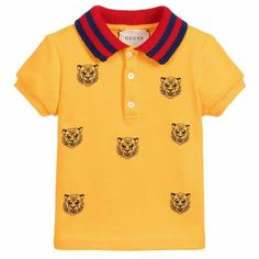 eaeb45d353b Baby boys yellow polo shirt with tiger embroidery from Gucci. Made in soft  cotton piqué, this mini-me design has a red and blue knitted rib collar and  ...