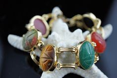Vintage bracelet   Gold tone Art Deco Jewelry circa  minimalist Modernist Graceful Multi Colored Faux Glass Carved Stone  multicolored  U076 by VintageEstate86 on Etsy