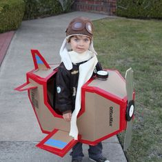 Our friends Ingrid and Nick Dragotta of Howtoons made their son Leo an airplane costume this year: he wore a bomber jacket and hat, and the plane is made of cardboard and tape. The best part? The gauge is actually a peanut butter jar that has a trick-or-treating candy bag attached, hidden in the nose of the plane. Clever and adorable!