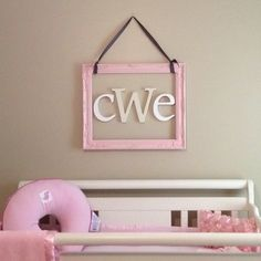 Monogram over the crib in our baby girl's nursery. :) Spray painted frame from Hobby Lobby. White letters currently for sale on Restoration Hardware Baby and off-white letter from PBK. It makes me happy and even more ready for her to arrive! :)