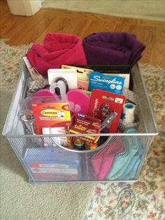 College gift basket I made for my little sister's HS graduation. It has washcloths, towels, first-aid kit, can opener, corkscrew, scissors, post-its, mini stapler, 5 Hour Energy, lint roller, adhesive strips & hooks, vinyl shower basket, collapsible laundry hamper, delicates laundry bag & flip flops for shower. I found it all at Bed Bath & Beyond, Target & Old Navy.