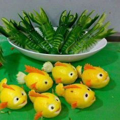 Lemon fish, cucumber shrimp and cucumber squid. The lemon fish look like Nemo! Fruits Decoration, Food Decorations, Lemon Fish, Fruit And Vegetable Carving, Veggie Art, Food Carving, Food Garnishes, Garnishing, Edible Food