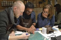 """Participants of the conservation course """"Inpainting and Loss Compensation on Paper"""". From left to right: Daniel Gillberg (Oslo Conservation Studio, Norway), Chanaka Perera (Qatar National Library) and the teacher, Amparo Escolano (South Florida Art Conservation)."""