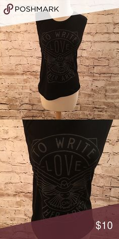 To Write Love on Her Arms Muscle T In great shape. This muscle T shirt is super soft and a comfy fit. To Write Love on Her Arms is an American non-profit organization which aims to present hope for people struggling with addiction, depression, self-injury and thoughts of suicide while also investing directly into treatment and recovery. Bella Tops Muscle Tees