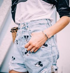 Disneyland/ Disney World summer outfit ideas. I love these high waisted denim shorts with the little embroidered Mickey heads all over them!