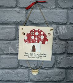 Tooth Fairy Plaque A hand painted plaque with either a Toadstool or Fairy door design. These can be made in any colour you wish. You will just need to tell me what colour you would like. Each plaque comes with a little wicker basket to leave your tooth in so the tooth fairy can collect it. You will also receive a little bottle of fairy dust with your order. The plaques are decorated with a ribbon, ladybirds, bees, a fairy (optional on the fairy door one) and a fairy door sign (toadstools…