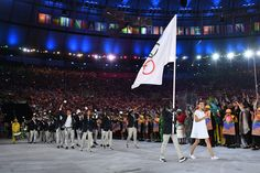 Refugee Olympic Team's flag bearer Rose Nathike Lokonyen leads the delegation during the opening ceremony of the Rio 2016 Olympic Games.