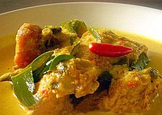 Ayam Masak Lemak Cili Padi - Delicious! Instead of 1L of coconut milk, I used 450ml coconut milk and 550ml water. I also omitted the candlenuts in the recipe, and the dish still turned out great! Yummm