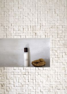 Create interest by cladding your shower recess with a different material to the rest of the shower walls
