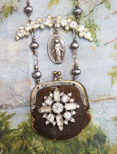 HEY!!! AND I HAVE THE LITTLE VINTAGE LEATHER  PURSE TO USE TO MAKE THIS WITH... Leather purse pendant