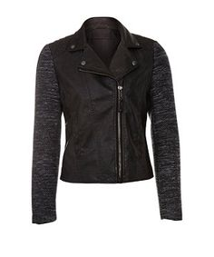 1745f02bb75 A juxtaposition of edgy and twee this black PU leather look biker jacket  features boucle sleeves