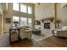 Two story living room // Stone fireplace // Large open windows