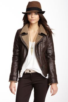 Sheep skin, leather jacket and fedora.  Black and brown