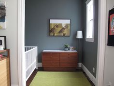 "love the wall color. (color is Kelly Moore ""Landmark"" & the code is any paint store can take that code and replicate the color in your paint of choice! it's a deep green with grey in it. it changes from blue tones to brown as the light hits it. Cabin Homes, Wall, Home, Storing Paint, Small Baby Room, House, Room Wall Colors, Wall Colors, Room"