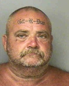 "Floyd Bebee, 48, from Florida, has ""Git-R-Dun"" bizarrely tattooed on his forehead in quite an elaborate font. He also has ""Got-R-Did"" on the back of his head."