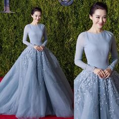 Actress Xu Qing was stunning in GEORGES HOBEIKA for the 69th Annual Tony Awards. Xu donned a light blue, sleeved princess gown with an embroidered tulle skirt from Georges Hobeika's FW Ready-to-Wear 15-16 collection.