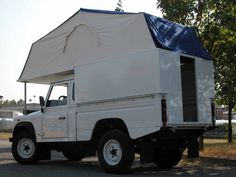 Landrover 110 pickup with flip over camper roof. Nice idea.
