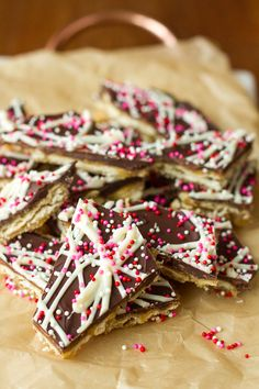 Saltine Cracker Toffee -- you won't believe how stupid easy this saltine cracker toffee recipe is, and it makes the most delicious and versatile candy ever! And you can totally customize the toppings and/or crackers to make this recipe entirely your own… | unsophisticook.com