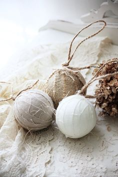 Rustic Christmas - the originator offers these for sale on Etsy, handmade in burlap and linen.  She wraps a styrofoam ball and adds jute twine. Am hoping to cover all of my cheap glass ornaments myself.