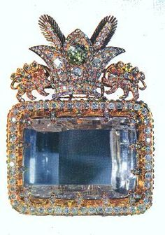Considered to be the most celebrated diamond in the Iranian Crown Jewels and one of the oldest known to man, the 186-carat Darya-i-Nur is a crudely fashioned stone measuring 41.40 × 29.50 × 12.15 mm. The name means Sea of Light, River of Light, or Ocean of Light. It is a table or 'taviz' cut diamond.    Both the Darya-i-Nur and the historic Koh-i-Noor are said to have been in the possession of the first Mogul emperor of India, from whom they descended to Mohammed Shah. When the latter was def...
