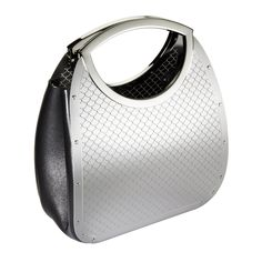 The Bib Bag is part of an evolving collection of stainless steel handbags by Wendy Stevens; hand-fabricated for durability with a versatile, modern flair. The bag is made of etched stainless steel with leather gussets, double handles and has a spring hinge closure. This piece can accommodate a wallet, cell phone and other accessories.