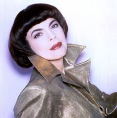 Mireille Mathieu made the pudding basin haircut fashionable