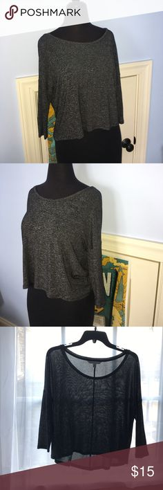 Gray stretchy crop top Dark grey stretchy material. Can be prone to snags but very easy to fix. 3/4 sleeves. Longer in the back, round neck. Fun to wear with a bralette because its a tad see through American Eagle Outfitters Tops Crop Tops