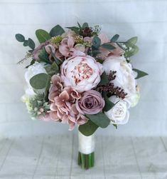 Bridal Bouquet 12 inches* *Bridesmaid Bouquets 7-8 inches* This romantic bouquet not only looks fresh and realistic but will be a keepsake for a lifetime without the worries of wilting fresh flowers. The gorgeous bouquet was handmade in shades of blush pink, dusty rose, ivory and white.