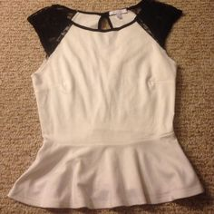 Delias peplum top Cute peplum top from delias. Cute lace sleeves and keyhole in back. Slight piling shown in the forth picture Delias Tops