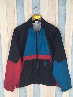 17e50a2865b NIKE Windbreaker Jacket Multicolor Medium Vintage 90s Nike Swoosh  Sportswear Nike Air Activewear Windrunner Zipper Jacket Size M by  JunkDeluxeRetro on Etsy
