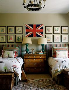 Twin beds, mini gallery wall above beds, boy style