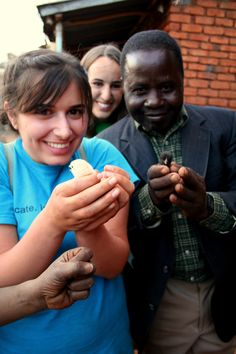 Interns play with baby chicks while on homestay in Malawi.