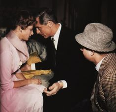 Cary Grant and Ingrid Bergman on the set of Indiscreet (1958).  Director Stanley Donen looks on.