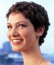 very short, curly hair in a boyish style with a fringe, or bangs