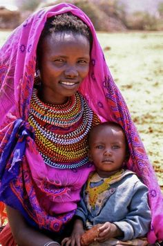 Color/Pattern(layering)/Drape(functionality)/Embellishment&Accessorizing - Rwanda | Mother with her child