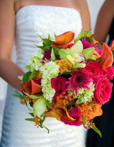 This Beautiful Bridal Bouquet Features: Hot Pink Gerbera Daisies, Magenta Garden Roses, Orange Roses, Flame Orange Calla Lilies, Green Cymbidium Orchids, Green Snowball Viburnum + Green Seeded Eucalyptus^^^^