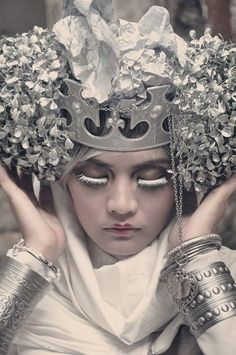 Silver Headress/Crown and cuffs.