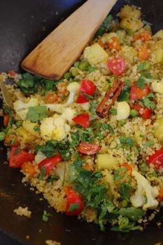 Vegan Indian Quinoa Vegetable pilaf: 1 cup quinoa -cooked in 2 cups water, 2 t. cumin, 1 medium potato or sweet potato, 1 carrot, 1 cup cauliflower, 1 cup peas, 1 T. chopped ginger, 1 t. salt, 1-2 T. olive oil, 2 bay leaves, 1/2 cinnamon stick, 2 cloves, 1 t. salt, 1/2 t. turmeric, 1/2 fresh lemon or lime, 1 tomato, salt, fresh cilantro, for garnish. Jesse's modification: no chile or sautéing