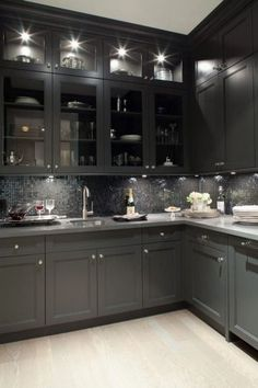We went for dark wood kitchen designs, and the offer is diversified, so you can pick some of these according to what you wish for for your new kitchen, either built from scratch or that overdue kitchen remodel you have been saving for. Go modern, rustic or minimalist and contemporary, and your kitchen will look great according to our books but remember you have the last saying. The most important part is that among these dark wood kitchen designs you find the kitchen you have been looking… Shaker Kitchen Cabinets, Grey Cabinets, Kitchen Backsplash, Upper Cabinets, Backsplash Ideas, Pantry Cabinets, Kitchen Countertops, Glass Cabinets, Grey Backsplash