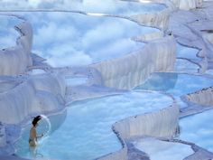 In the province of Denizli in western Turkey, the naturally terraced thermal springs of Hierapolis-Pamukkale date as far back as the second century BC. Formed by calcite in the water, the hot springs look like stunning white clouds.