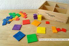 Kreis aus farbigen Quadraten in den Farben des Regenbogens, gelegt mit dem Legespiel 7 nach Fröbel