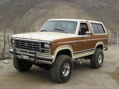 1980 ford bronco- Love broncos and how you can take the back top off which makes it feel like a big stout Jeep!!! :^)