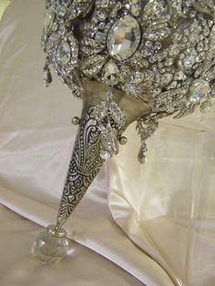 Fabulous and decadent vintage crystal brooches fashioned into the ultimate custom-made, one-of-a-kind wedding bouquet by CrystalBroochBouquet, Etsy....