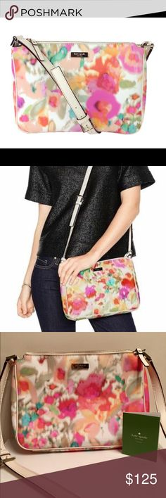 """KATE SPADE GRANT STREET CHRISSY FLORAL CROSS-BODY Beautiful Kate Spade Grant Street Chrissy cross-body bag in Giverny Floral, a watercolor floral print. Hardly used. Comes with care card.  Features: crossbody with zip top closure saffiano textured grainy vinyl with smooth leather trim gold embossed kate spade new york logo interor zipper and double slide pockets 5.5""""h x 9.4""""w x 2.3""""d 21"""" drop    No Trades     Fast Shipping   Open to Offers     Smoke Free Home  ❓Feel Free to Ask…"""